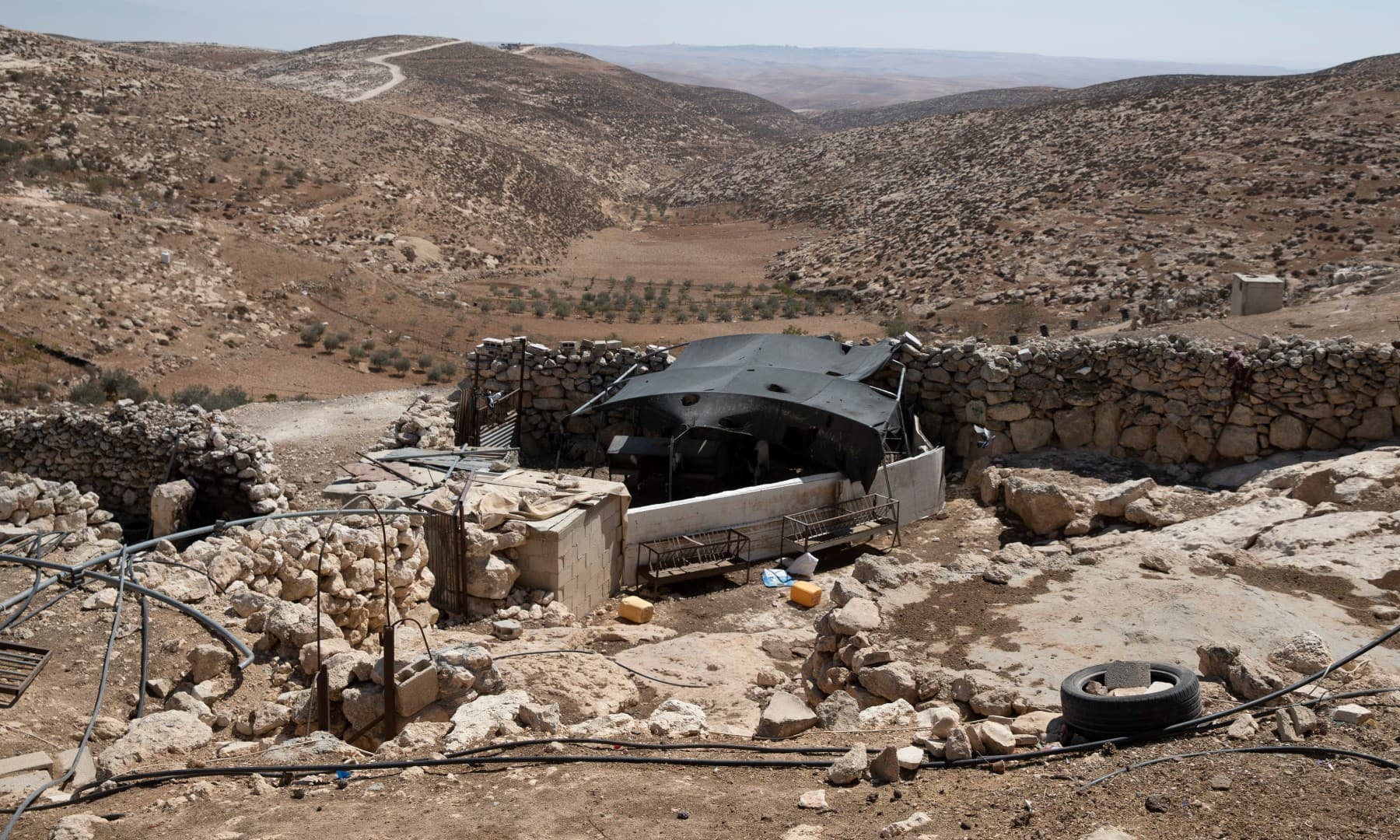 A stockyard that suffered damage following a settlers' attack from nearby settlement outposts on the Bedouin community, in the West Bank village of Al-Mufagara. Sept. 30. — AP