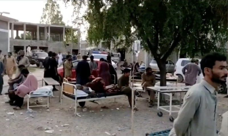 People gather outside a hospital following an earthquake in Harnai, Balochistan. — Reuters via social media