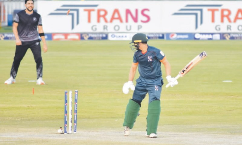 Stand-in Balochistan captain Bismillah Khan surveys his stumps after being castled by Khyber Pakhtunkhwa speedster Shaheen Shah Afridi during the National T20 Cup match at the Pindi Cricket Stadium on Saturday. — Tanveer Shahzad/White Star