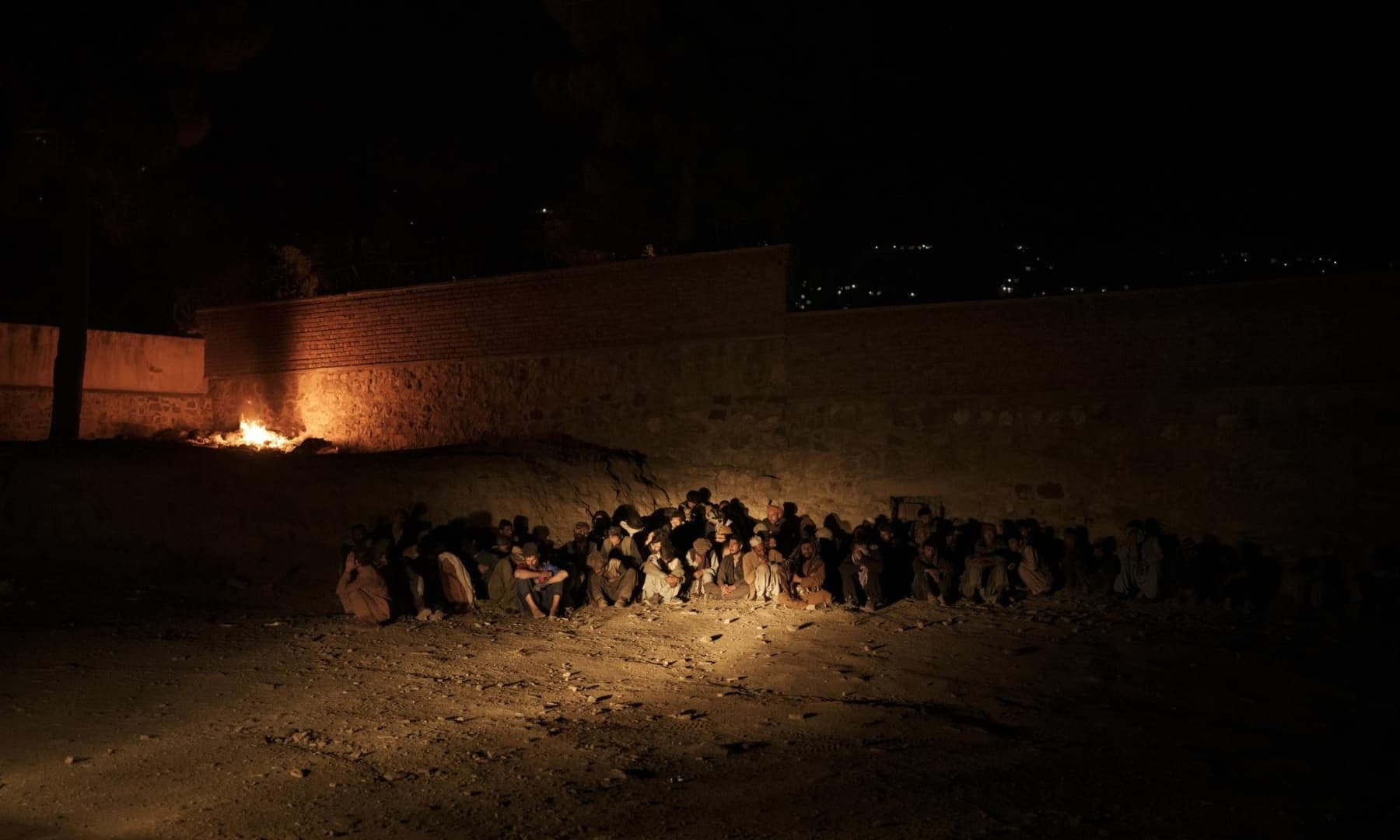 Drug users detained during a Taliban raid sit at a police station as they wait to be transferred to the Avicenna Medical Hospital for Drug Treatment in Kabul, Afghanistan, October 1, 2021. — AP