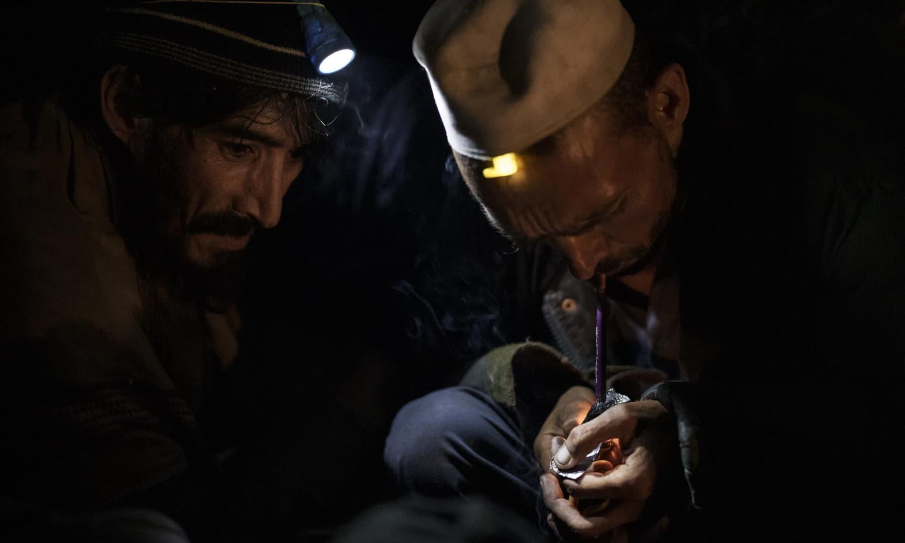 Drug users consume heroin in Kabul, Afghanistan, October 1, 2021. — AP