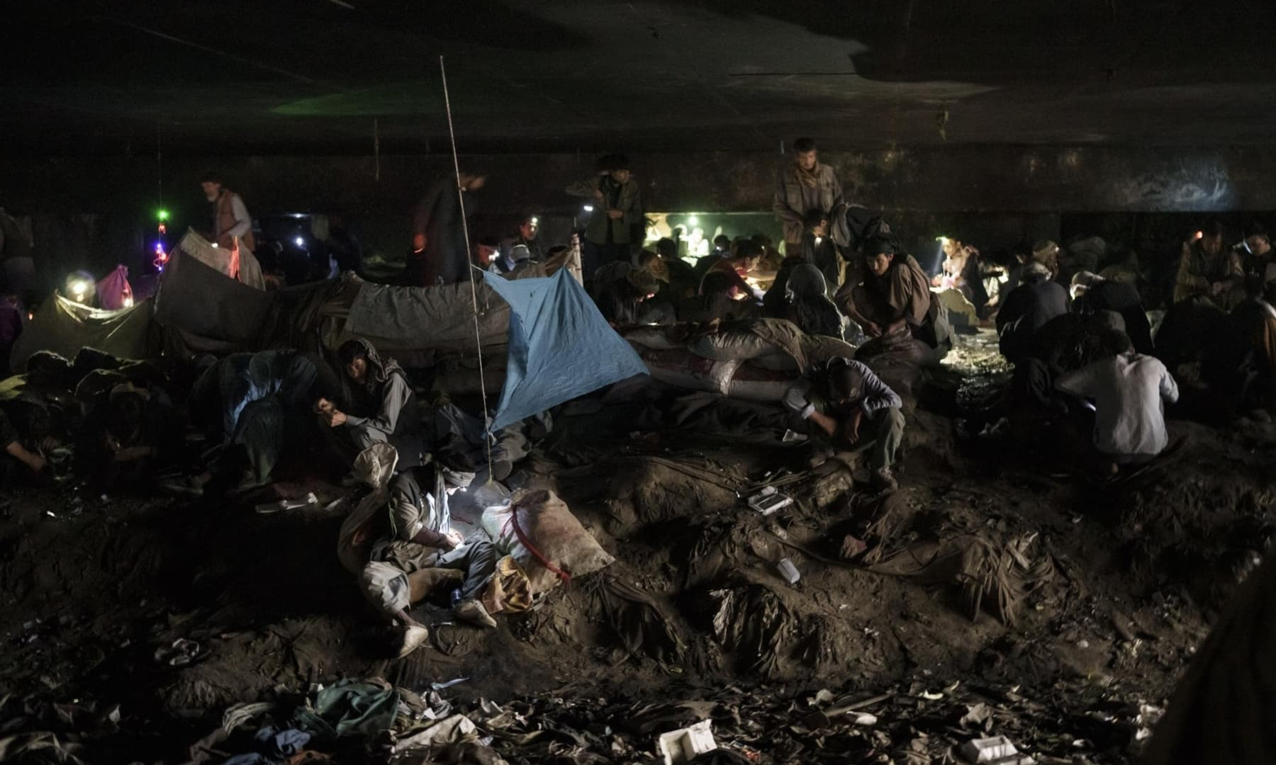 Afghans gather under a bridge to consume drugs, mostly heroin and methamphetamines in Kabul, Afghanistan, September 30, 2021. — AP