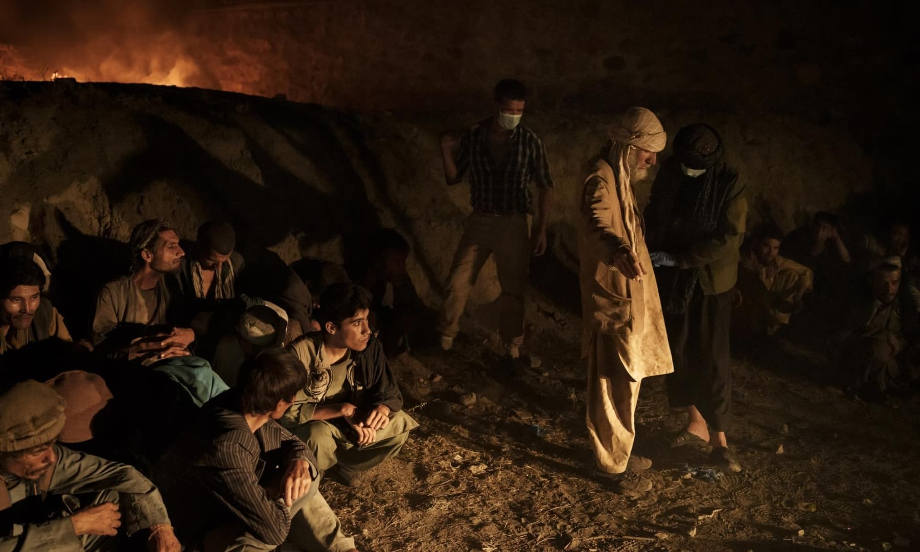 Drug users detained during a Taliban raid wait to be checked at a police station before being transferred to the Avicenna Medical Hospital for Drug Treatment in Kabul, Afghanistan, October 1, 2021. — AP