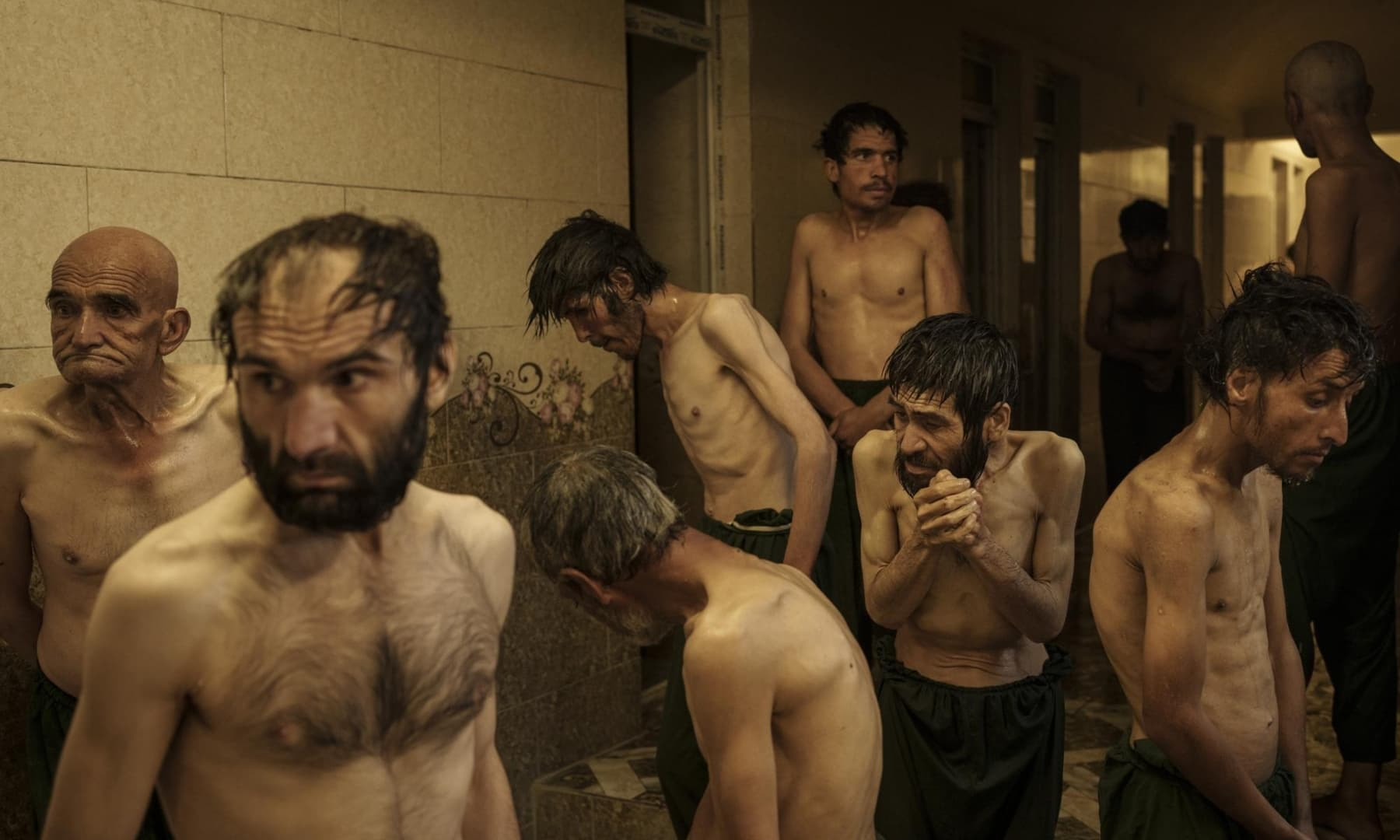 Drug users detained during a Taliban raid wait to be shaved after arriving at Avicenna Medical Hospital for Drug Treatment in Kabul, Afghanistan, October 1, 2021. — AP
