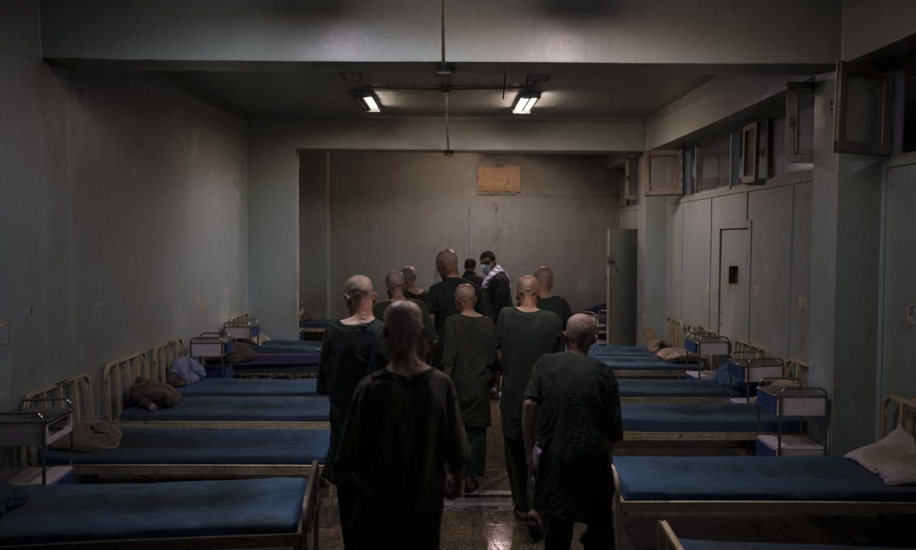 Drug users detained during a Taliban raid are taken to their room at the detoxification ward of the Avicenna Medical Hospital for Drug Treatment in Kabul, Afghanistan, October 2, 2021. — AP
