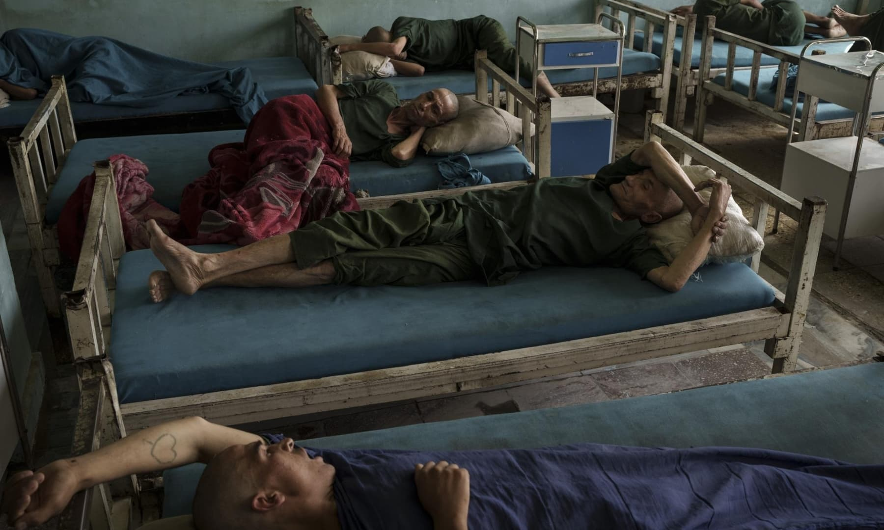 Drug users detained during a Taliban raid rest at the detoxification ward of the Avicenna Medical Hospital for Drug Treatment in Kabul, Afghanistan, October 4, 2021. — AP