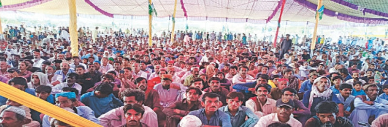 PARTICIPANTS in the Miladun nabi conference listen to their leaders' speeches in Islamkot on Thursday. — Dawn
