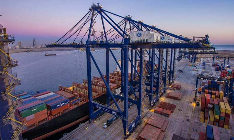 Cranes poised above shimmering waters at the Pakistan Deep Water Container Terminal at Keamari. — Dawn/File