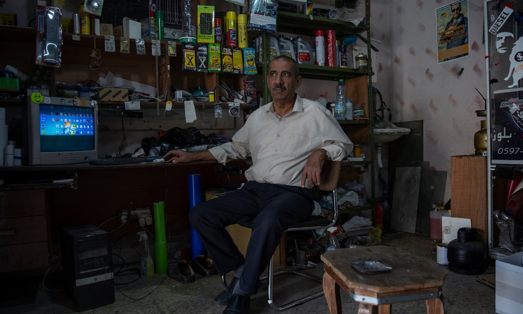 Palestinian Mustafa Erekat, whose son Ahmed was shot dead by Israeli forces at a West Bank checkpoint last year and held his body after, sits at his shop in the village of Abu Dis, South of Ramallah, Palestine on September 24, 2021. — AP