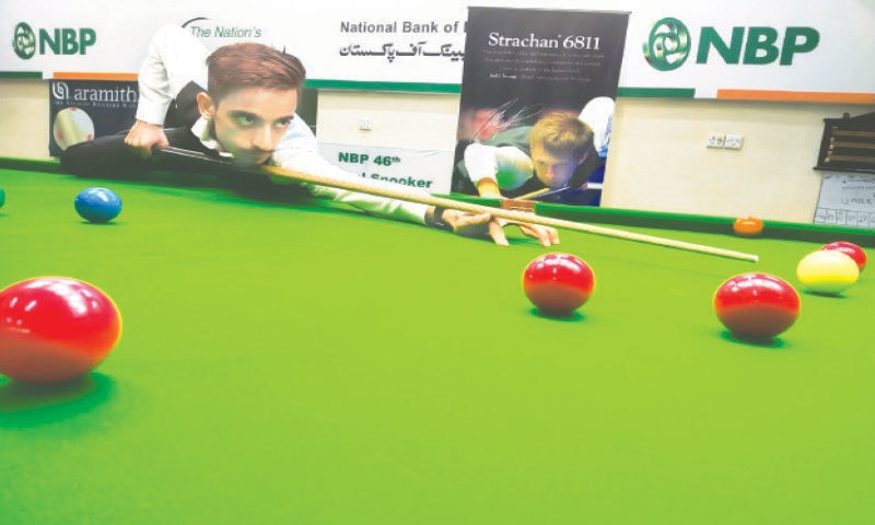 NATIONAL under-17 champion Ahsan Ramzan prepares to pot the ball against Umair Haider during their NBP 46th National Snooker Championship match on Friday.