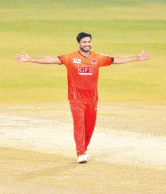 RUMMAN Raees Khan celebrates one of his three wickets in as many balls.—M. Arif/White Star
