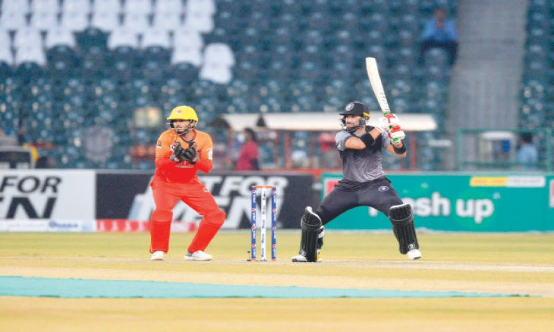 LAHORE: Khyber Pakhtunkhwa skipper Iftikhar Ahmed drives powerfully during his undefeated half-century as Sindh wicket-keeper Ahsan Ali looks on in the National T20 Cup match at the Gaddafi Stadium on Saturday. —Murtaza Ali/White Star