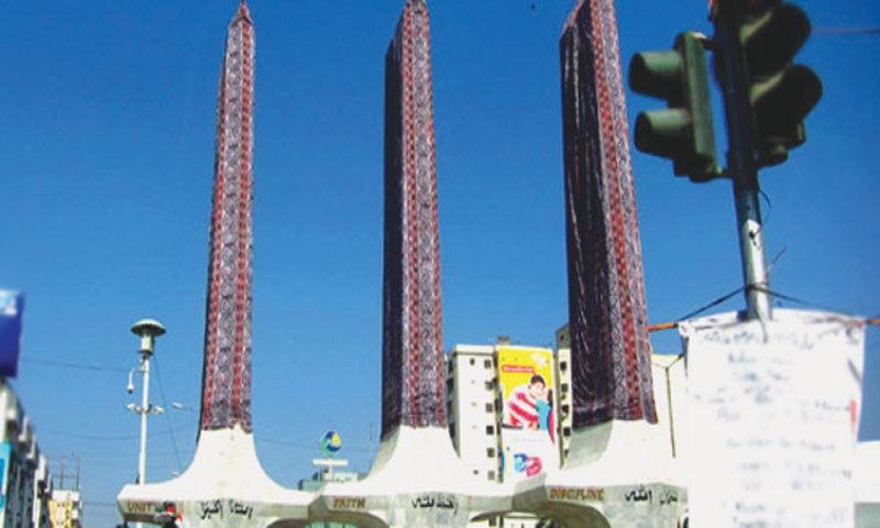Karachi's famous landmark Teen Talwar [Three Swords] draped in Sindhi Ajrak   Dawn file photo