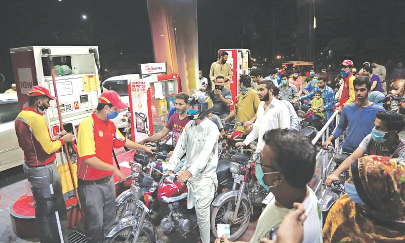 A file photo shows people lined up at a petrol station following announcement of increased fuel prices set to be implemented the next day   White Star