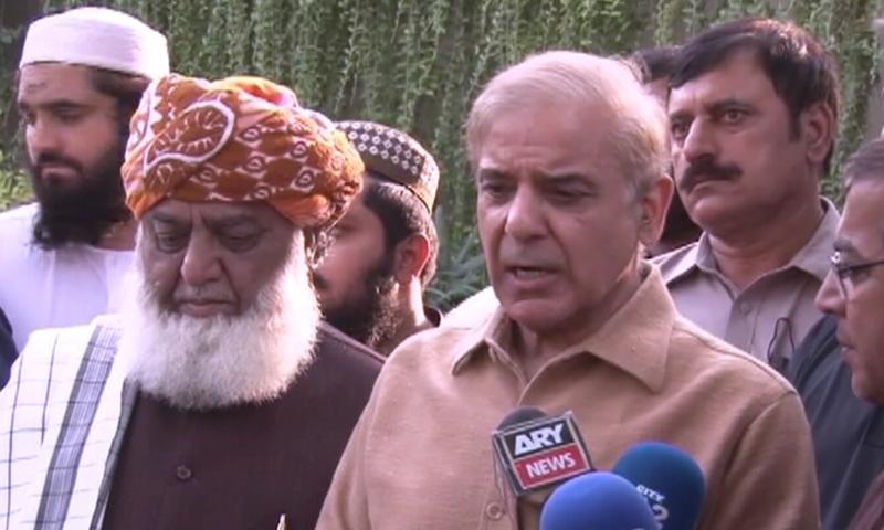 PML-N President Shehbaz Sharif and JUI-F chief Maulana Fazlur Rehman speak to the media in Lahore on Saturday. — DawnNewsTV