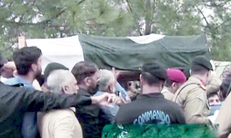 Dr Abdul Qadeer Khan's coffin being carried to his funeral prayers. — DawnNewsTV
