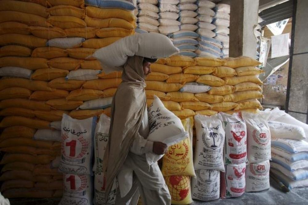 In this file photo, a man carried a bag of flour. — Reuters/File