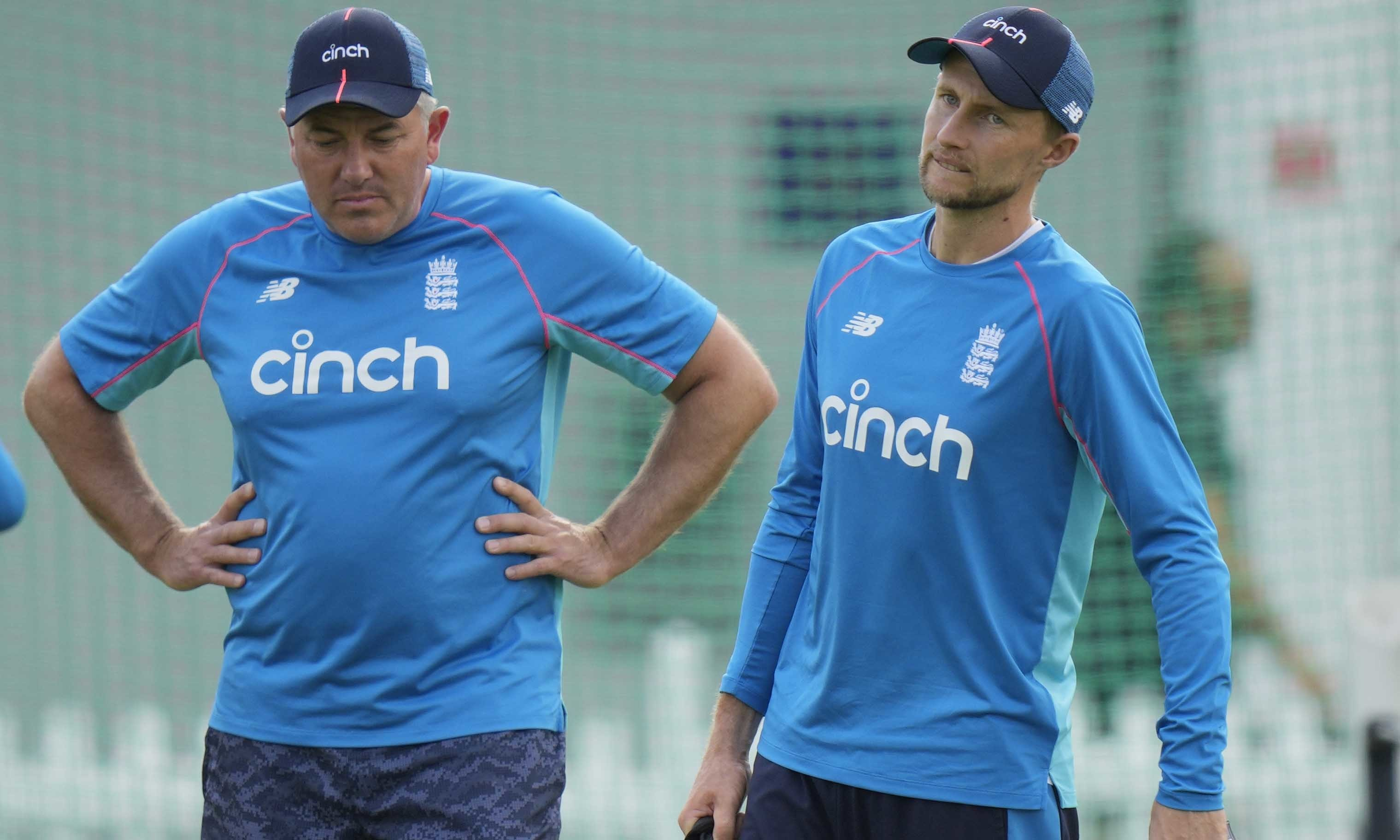 In this file photo taken on Aug 10, England's cricket coach Chris Silverwood, left, speaks his team captain England's Joe Root during a practice session in London. — AP