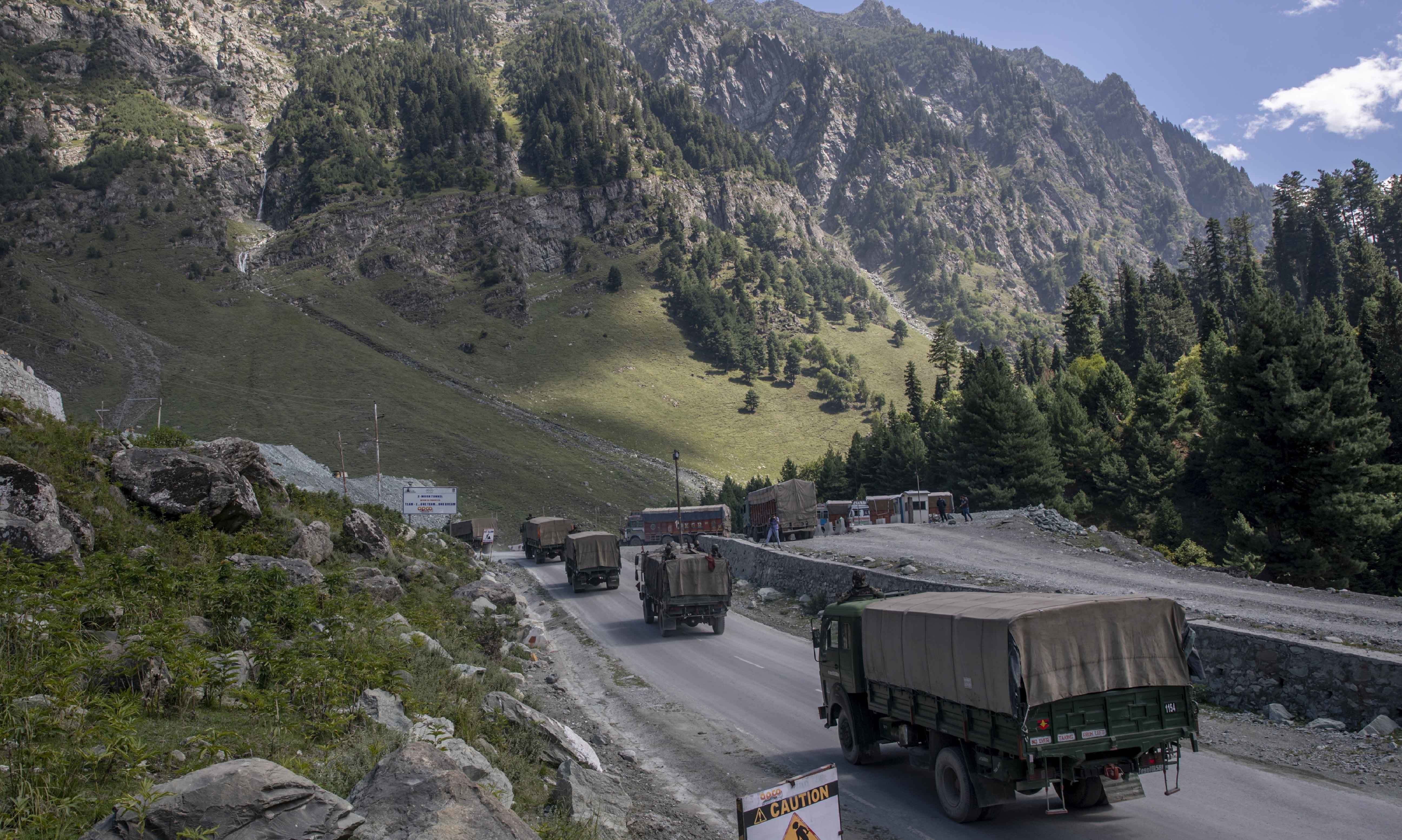 In this September 9, 2020, file photo, an Indian army convoy moves on the Srinagar-Ladakh highway at Gagangeer. — AP