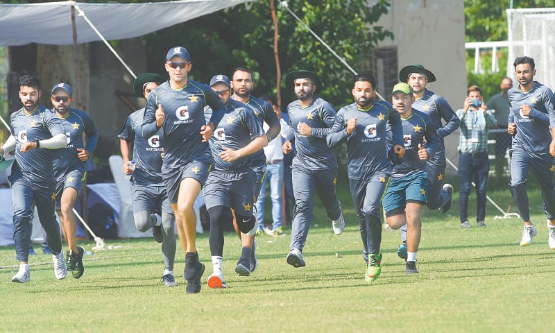 Pakistan cricketers run during a training session at the LCCA ground on Monday.—M.Arif/White Star