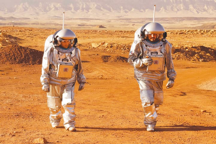 ASTRONAUTS train at a site in Israel's Negev desert that simulates the conditions on Mars.—AFP