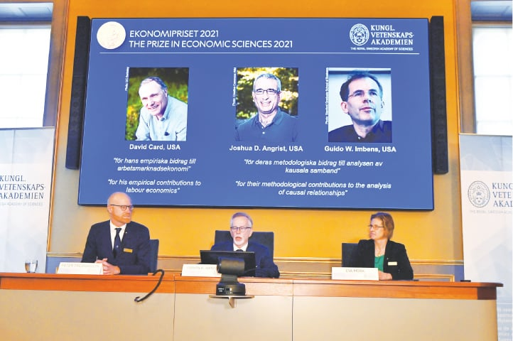 Goran Hansson, the Royal Swedish Academy of Sciences secretary general, and other members of the committee for economics, announce the winners' names during a news conference in Stockholm.—Reuters