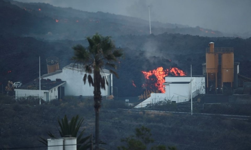 Lava rolls down behind a cement factory in Los Llanos as the Cumbre Vieja volcano continues to erupt on the Canary Island of La Palma, as seen from Tajuya, Spain, October 11. — Reuters