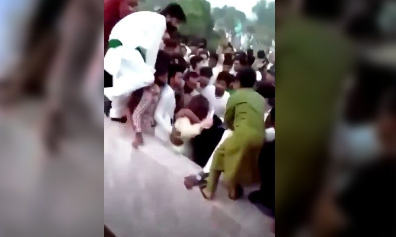 This screengrab shows a female TikToker being assaulted on August 14 when hundreds of youngsters were celebrating Independence Day near Minar-i-Pakistan. — Twitter screengrab/File