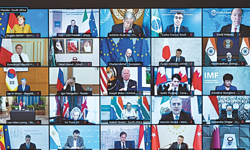 ROME: A screen shows world leaders taking part virtually in an extraordinary meeting of G20 on Tuesday.—Reuters