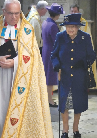 LONDON: Britain's Queen Elizabeth arrives at Westminster Abbey on Tuesday to attend a thanksgiving service to mark the centenary of the Royal British Legion.—Reuters