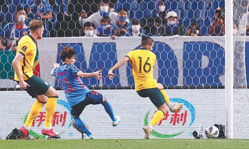 SAITAMA: Australia's Aziz Behich (R) scores an own goal for Japan's late winner during their 2022 FIFA World Cup qualifier at the Saitama Stadium on Tuesday. —Reuters
