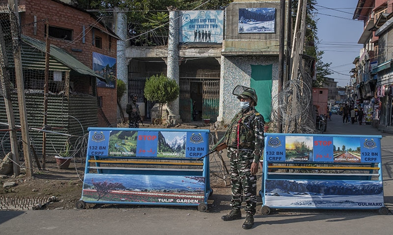 An Indian paramilitary soldier stands guard near his bunker in Srinagar, Indian-occupied Kashmir, on Tuesday. — AP