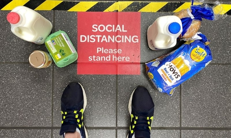 Food shopping is seen on the floor next to a social distancing sign and markings as a customer waits in a queue at a Spar supermarket, following the outbreak of the coronavirus in Hemel Hempstead, Britain, April 24, 2020. — Reuters/File