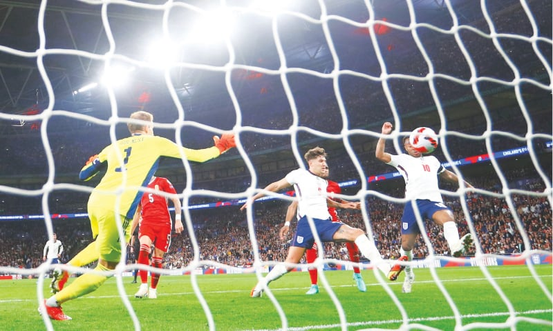 LONDON: England's John Stones (second R) scores during the 2022 FIFA World Cup qualifier against Hungary at Wembley.—Reuters