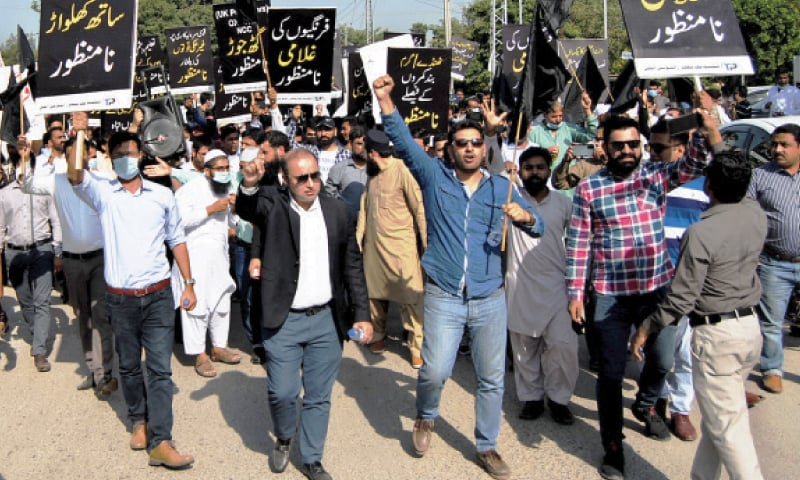 Local publishers protest outside the National Curriculum Council in Islamabad on Wednesday. — White Star