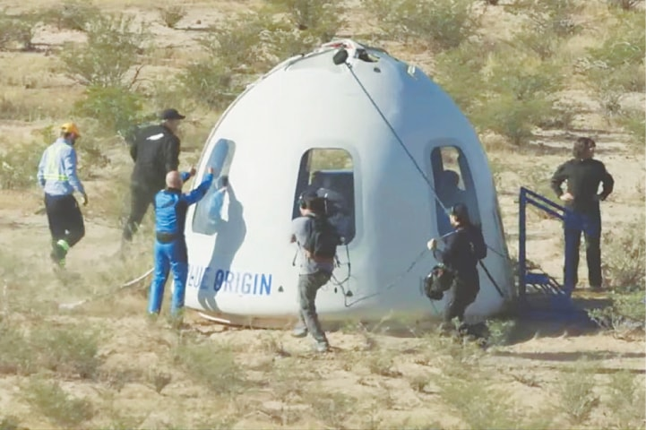 Billionaire Jeff Bezos gives a thumbs-up outside the capsule of Blue Origin's New Shepard mission, which carried Star Trek actor William Shatner and three other passengers on a suborbital flight, after it landed by parachute in  Texas.—Reuters