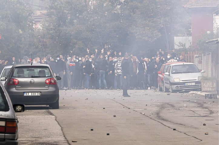 Ethnic Serbs block a street in the Serb-dominated part of Mitrovica, an ethnically divided town in Kosovo, on Wednesday.—AP