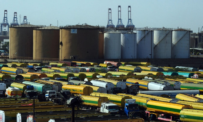 An overview shows tankers parked outside a local oil refinery in Karachi. — AFP/File