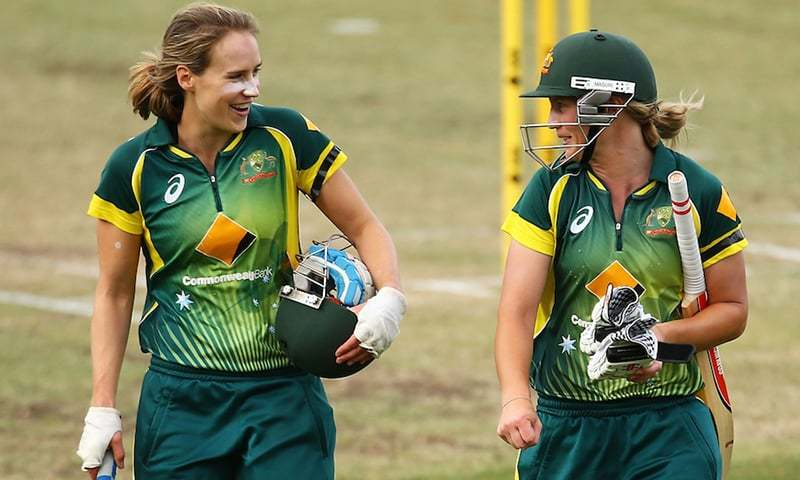 In this file photo, Australia's Ellyse Perry and Meg Lanning walk back after crushing West Indies in a match on Nov 16, 2014. — Picture courtesy: Cricket Australia