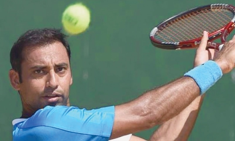 Pakistan's top tennis player Aqeel Khan is seen in action during a match. — File photo
