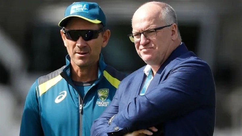 CA Chairman Earl Eddings (R) and team coach Justin Langer (L) are seen in this file photo. — AFP/File