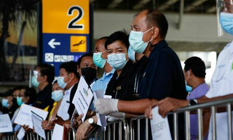 In this file photo, hotel drivers wait for passengers at the airport in Phuket, Thailand. — Reuters/File