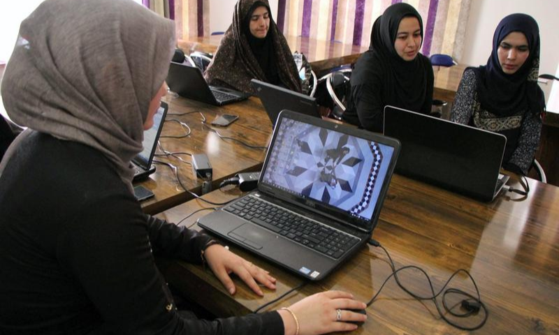 Afghan girls learn to code 'underground' to bypass Taliban curbs