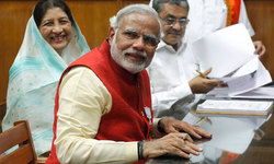 Wary of Chinese advances, India's Modi woos neighbours