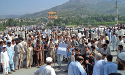 Villagers block road against power suspension