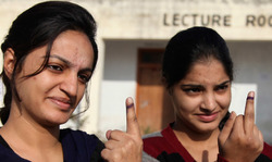 Young migrant Kashmiri Hindus display the indelible ink mark on their fingers after casting their votes. — Photo by AP