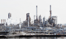 Sinking oil prices, inventory losses