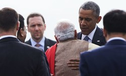 Modi hugs Obama at start of three-day India visit