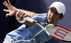 Aisam, Zimonjic crash out