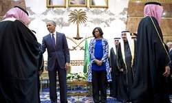 Michelle Obama draws flak for going without headscarf in Saudi Arabia